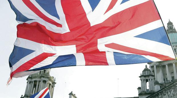 Row: Union flags flying at Belfast City Hall as part of a protest