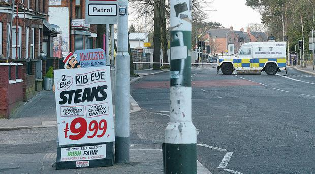 Police seal off the Falls Road after the dissident bomb attack
