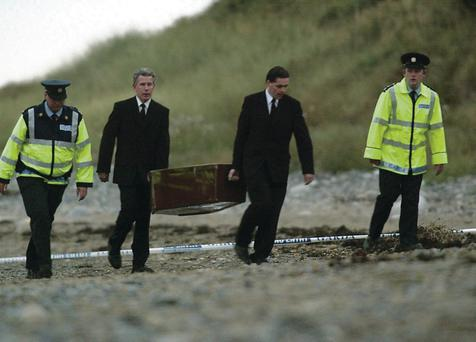 Jean's remains are removed from the burial site in 2003