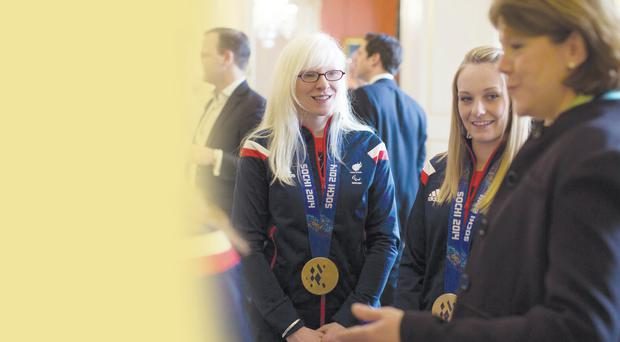 Secretary of State for Culture, Media and Sport Maria Miller (right) greets members of the Winter Paralympic Team GB, including gold medal winning skiers Kelly Gallagher (centre) and Charlotte Evans (second right)