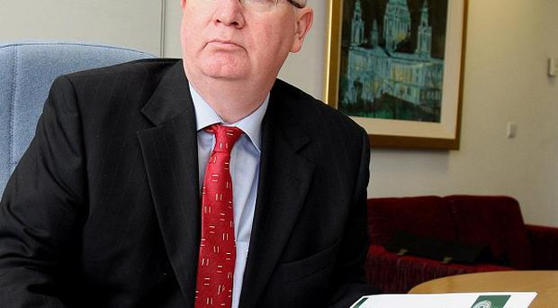Police ombudsman Dr Michael Maguire recommended two officers be switched to different duties during his investigation