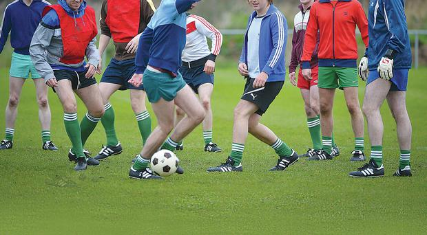 A scene from 'Shooting for Socrates' with Ciaran McMenamin (centre) playing the role of Sammy McIlroy