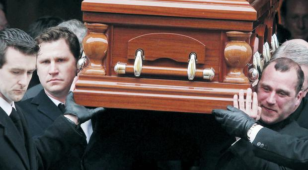 Edward Haughey's coffin is brought into the Cathedral of St Patrick and St Colman in Newry