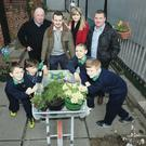 At the opening of the newly greened alleyway were Gaelscoil Na Bhfal pupils Dáire Russell, Lorcán Phillips, Iseult Fegan Ní Mhathúna and Dubhaltach Crawford with local resident Eamon McGonigle, councillor Ciaran Beattie, urban regeneration officer Declan Hasson, and Ruth Magennis, from the West Belfast Partnership Board