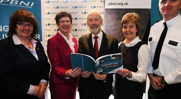 Justice Minister David Ford, centre, joins the Probation Board NI at the launch of its corporate plan for the next three years (PBNI/PA)
