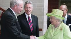 Sinn Fein's Martin McGuinness shakes hands with the Queen at the Lyric Theatre in 2012