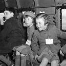 Children who lost parents during the war enjoy a trip on board a Dakota aircraft