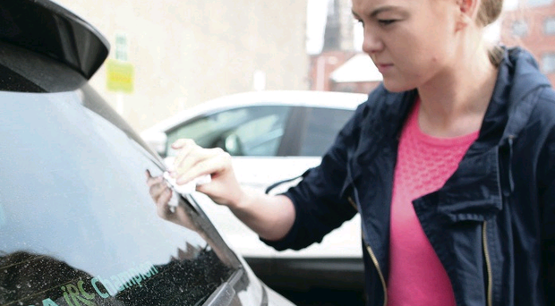 Keely Rafferty cleans Saharan sand from her car