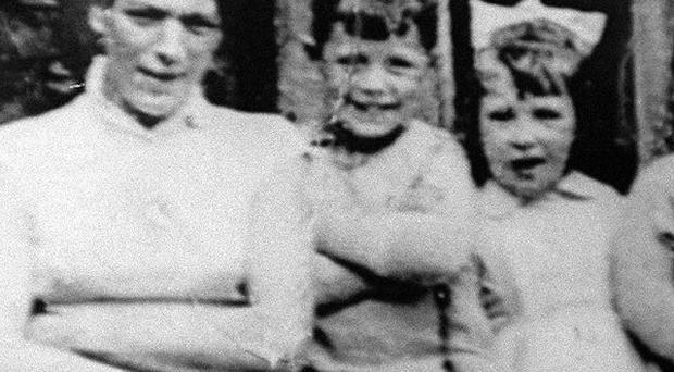 Jean McConville, left, pictured with some of her 10 children. her son Michae says he will not tell police who was responsible in case he is shot.