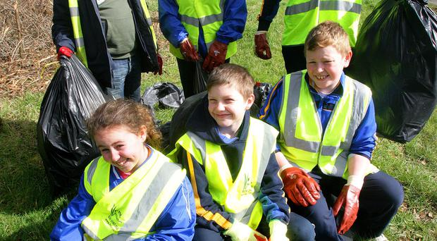 Getting stuck in were (back) councillor Henry Cushnahan, Siobhan Murray, Ronan McKee and (front) Dervla Murray, Nathan McKee and Keenan Murray