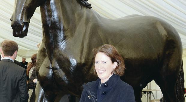 Artist Camilla Le May with her bronze statue of Sefton