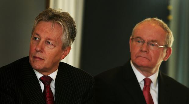 First Minister Peter Robinson (left) has accused his deputy Martin McGuinness of failing to deliver on a deal agreed last May