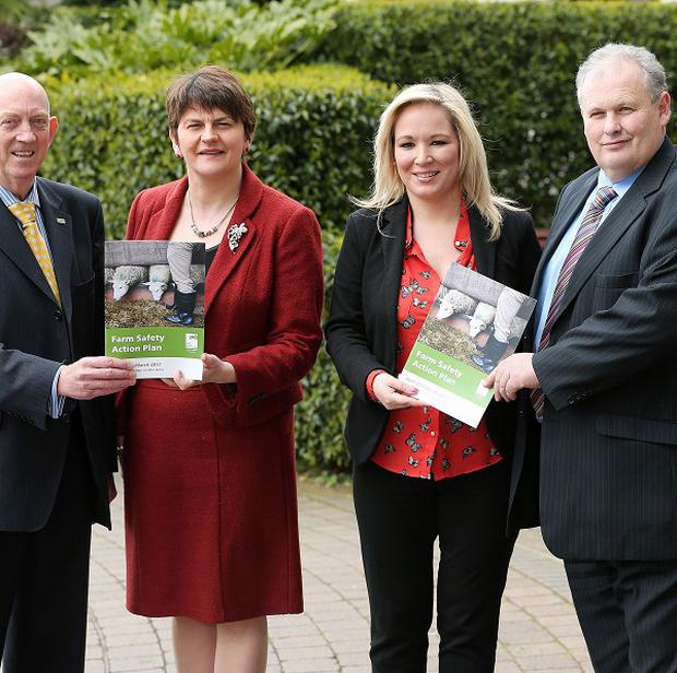 George Lucas, HSENI chairman; Enterprise Minister Arlene Foster; Agriculture Minister Michelle O'Neill and Harry Sinclair, UFU president at the launch of the Farm Safety Action Plan Taking the Next Steps to Safer Farms (Press Eye/PA)