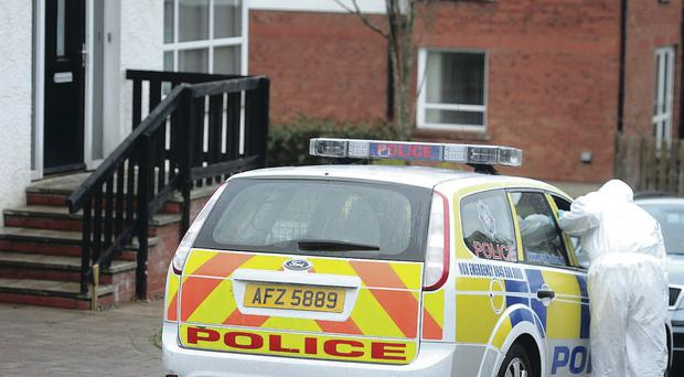 Police forensics officers at the house in Newtonabbey aafter a family of four were victims of violent burglary