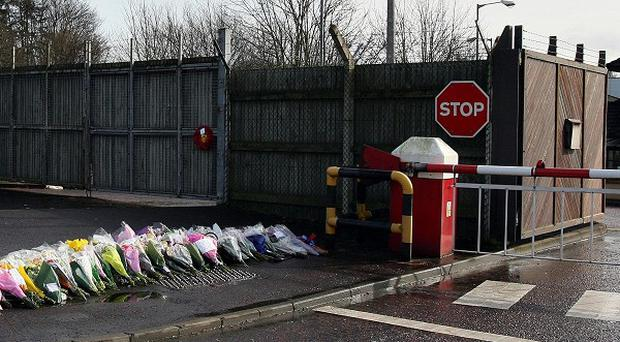 Flowers and cards left outside Massereene Army Base in Antrim where the two soldiers were shot dead in 2009