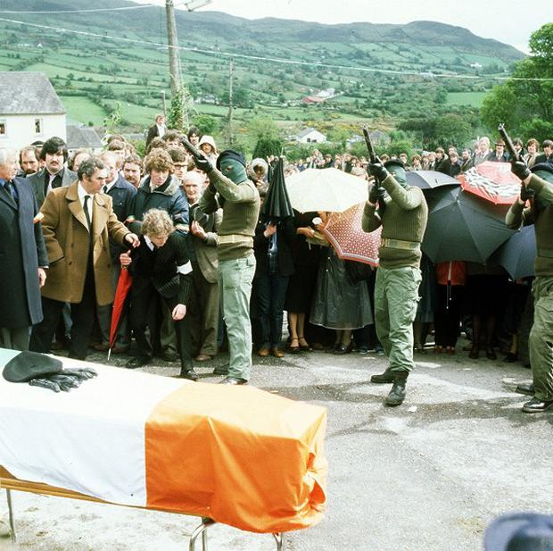 Masked gunmen fire shots over the coffin of IRA hunger striker Raymond McCreesh in Camlough, South Armagh