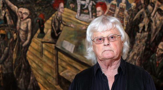 Artist Jack Pakenham in front of his work entitled Peace Talks at the Ulster Museum, which is part of the new Art of the Troubles exhibition