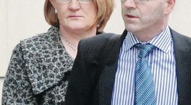 Eilish Hackett, the mother of Sean Hackett, leaves Belfast Crown Court with the family solicitor