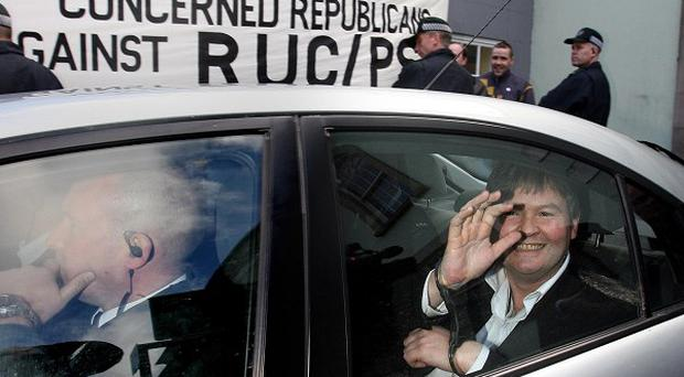 Gerry McGeough leaves Enniskillen court handcuffed in a police car