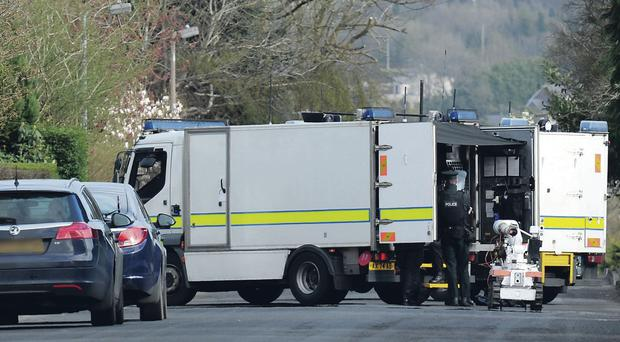Army bomb disposal experts in Talbot Park in Londonderry using a robot after the bomb was discovered