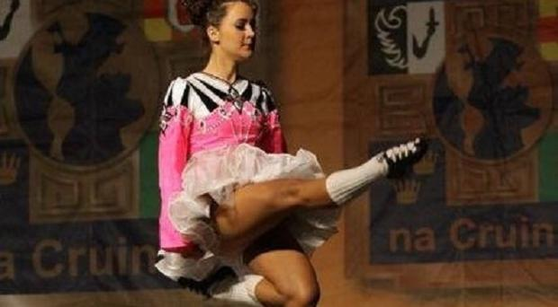 Megan Brady, 18, takes part in the Worlds of Boston dancing competition as she gets ready to compete in the 44th World Irish Dancing Championships