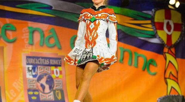 A dancer competes in the World Irish Dancing Championships in central London.