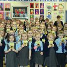 The pupils of Carrickfergus Central primary school with their packets of sunflower seeds