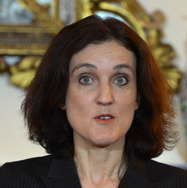 Theresa Villiers said most people do not wake up in the morning thinking about the Troubles