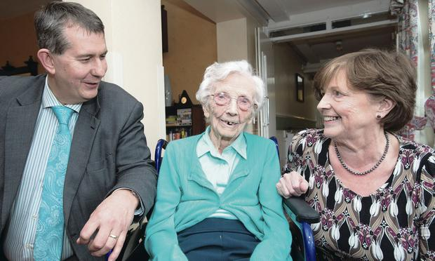 Health Minister Edwin Poots talks to Lettie Doherty (100) and her daughter Josie McCann at Thackeray Place in Limavady Martin McKeown