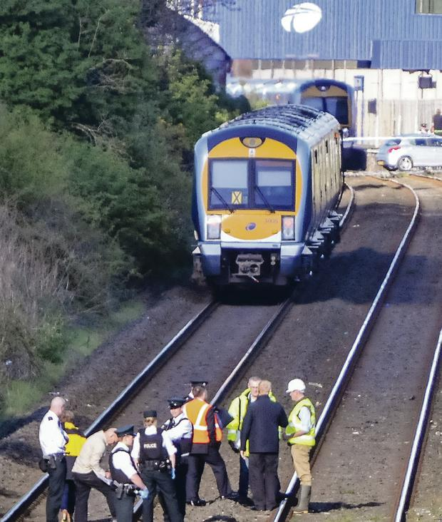 Police and emergency crews at the scene of the death on the rail track outside Lurgan