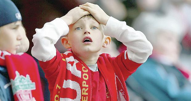 A young Liverpool fan shows his emotions