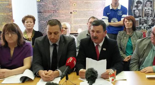 John Teggart (centre right), whose father Daniel was killed, speaks as the Government rejected a call for an independent re-examination of a British Army operation that left 11 people dead in west Belfast
