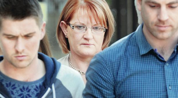 Widow Ailish Hackett leaves Belfast Crown Court this afternoon with family and friends