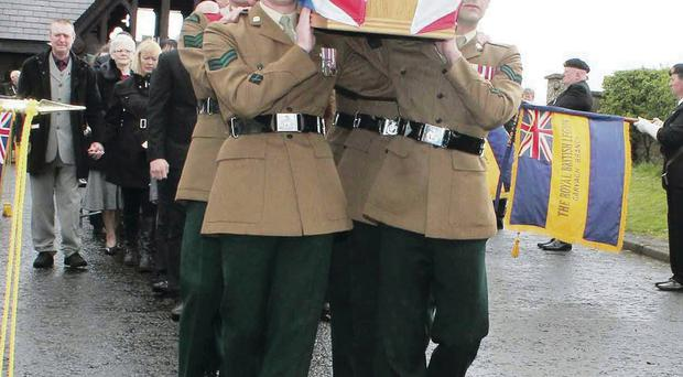 Colleagues of Corporal Geoffrey McNeill in 1st Battalion The Royal Irish Regiment carry his coffin