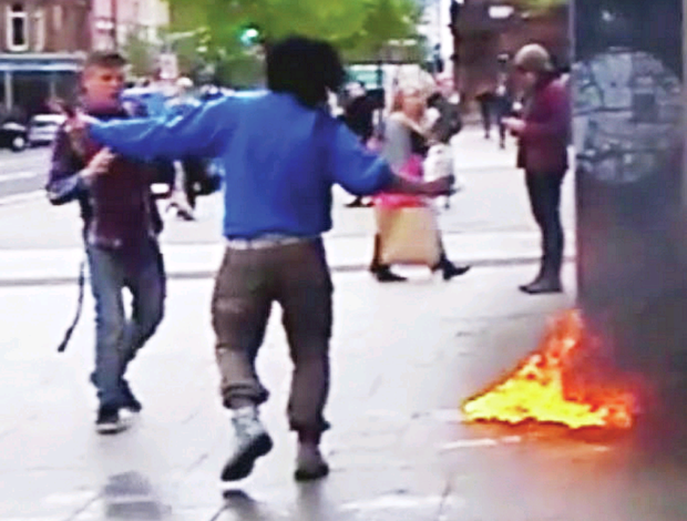 Teenager Paul Russell challenges the asylum seeker about to set himself on fire outside Belfast City Hall