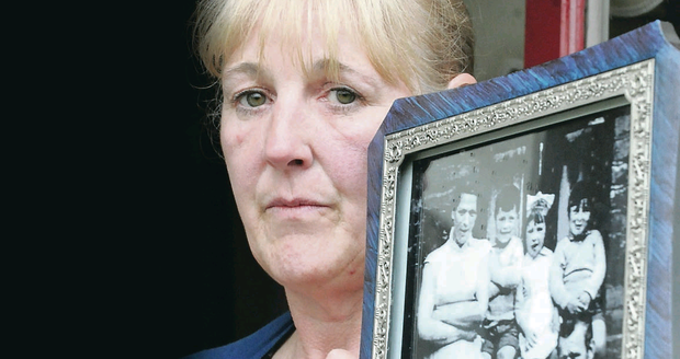 Helen McKendry holding a picture of her mother