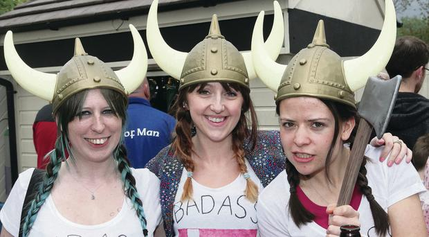Kelly, Catrina and Natalie from Biokinetic taking part in Cutters Wharf 14th annual Viking Boat Race