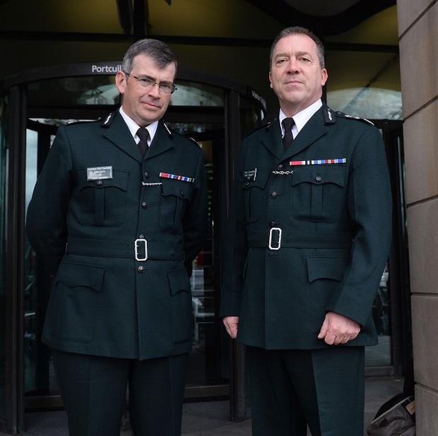 PSNI Chief Constable Matt Baggott, right, and Assistant Chief Constable Drew Harris arrive at the House of Commons to give evidence to the Northern Ireland Affairs Committee