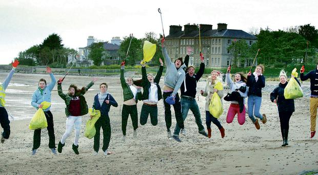 Volunteers from McDonald's at Dundonald celebrate the success of the Big Spring Clean at Sea Park Beach