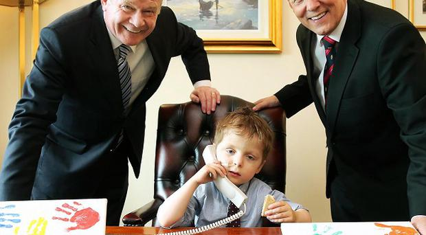 Oscar Knox pictured last summer with First Minister Peter Robinson and deputy First Minister Martin McGuinness at Parliament Buildings in Belfast (Press Eye/PA)