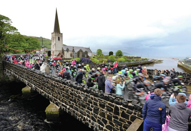 The peloton passes through Glenarm village