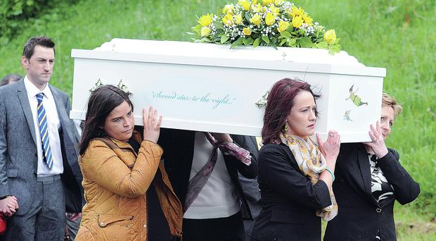 Heartbreaking: family and friends carry the coffin to the church