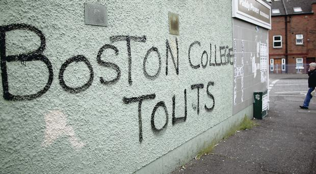 Graffiti on the Falls Road in Belfast directed at those who gave interviews for the Boston project