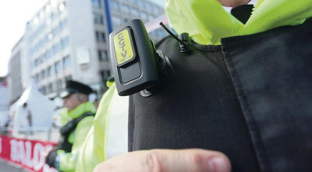 Officers test the cameras during the Giro in Belfast