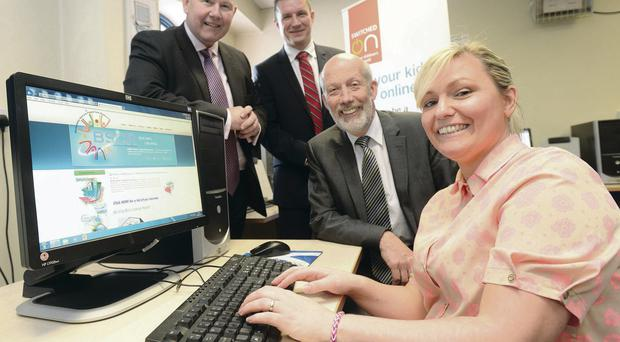 Belfast mother Nikki Johnston with (from right) Justice Minister David Ford, Get Safe Online chief executive Tony Neate and Detective Chief Inspector Douglas Grant from Organised Crime Branch