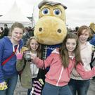 Shannon Connor, Kate Lyness, Loren Strain and Avine Walsh from Newcastle make friends with Ulster Bank's Henri Hippo