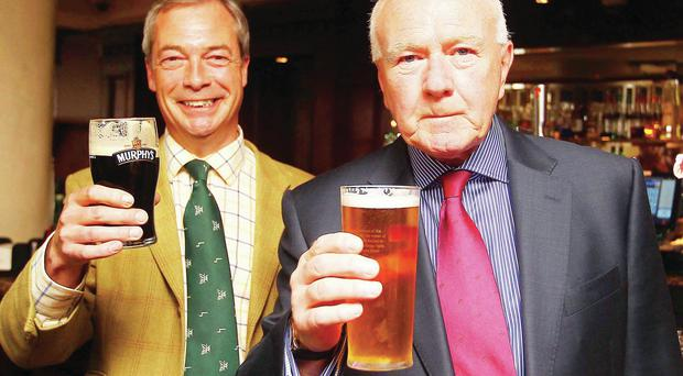 Ukip leader Nigel Farage enjoys a pint of Murphy's in the Europa with Ukip MLA David McNarry