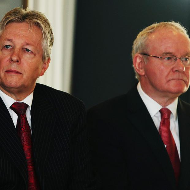 Northern Ireland First Minister Peter Robinson (left) has hit back at comments by deputy First Minister Martin McGuinness