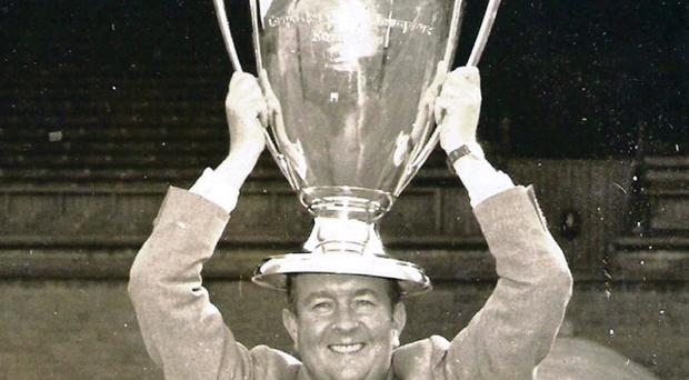 Charlie Tully holds aloft the European Cup which had been won by Celtic's Lisbon Lions in 1967