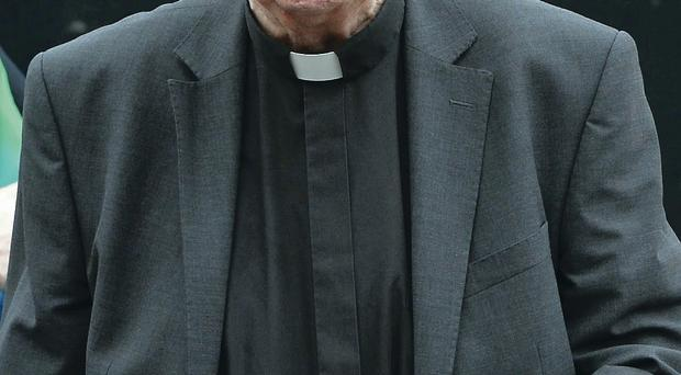 Bishop Edward Daly leaves Banbridge courthouse yesterday after giving evidence to the historical abuse inquiry